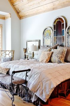 I love the glass in the cathedral window inspired headboard.