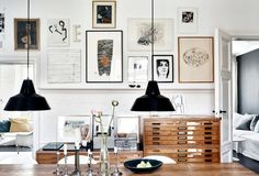 Dining room with a long table and on the wall a collection of favorite pictures and artworks