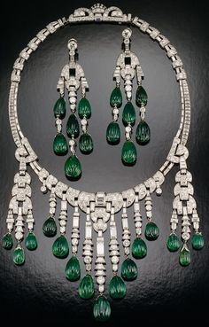 Emerald and diamond necklace – Designed by Ostertag; set with carved emeralds and diamonds in platinum; circa 1930.