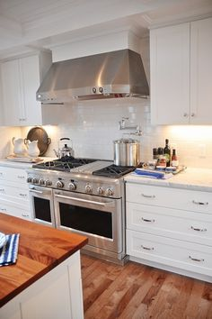 White kitchen, subway tile, butcher block and stainless steel. HGTV Dream Home #HGTV #HGTVDreamHome