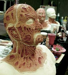 Robert Kurtzman preps Freddy Kruger make-up for Robert Englund one last time.