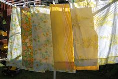 sunny yellow vintage pillowcases on clothesline--love this!