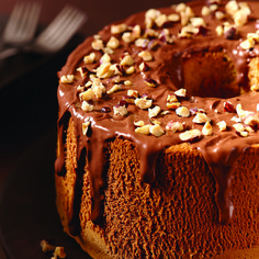 Known for its airy texture, this chiffon cake recipe is made lighter by eight whipped egg whites and flavored with the addition of coffee in the batter. Topped with warmed hazelnut spread and chopped hazelnuts, this lighter-than-air cake makes a great dessert or teatime snack.