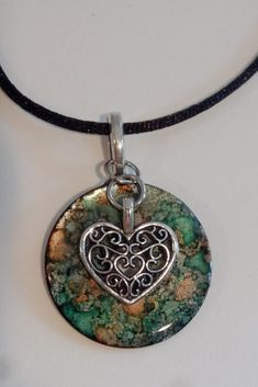 alcohol ink washer pendant with filigree heart charm created by c.ryan