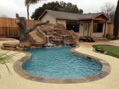 small pool with water feature and slide