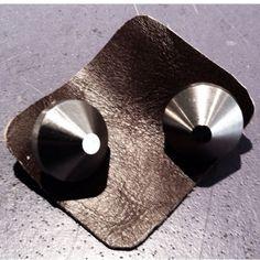 Titanium #cufflinks with a bite.  #hybridshopping #bergen