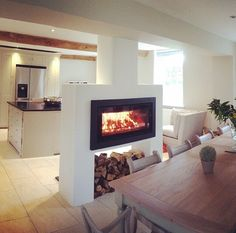 Installation of a Stovax Duplex double sided wood burning inset stove installed by The Fireplace Fitters Shop