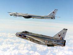 An RAF English Electric Lightning fighter jet intercepting a Soviet Air Force Bear heavy bomber. Military Jets, Military Aircraft, Fighter Aircraft, Fighter Jets, V Force, War Jet, Plane Photos, Royal Air Force, Cold War