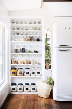 By removing the doors, a pantry has been converted to open shelving – a lovely, country-style way to turn staples into a fabulous display.