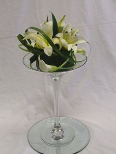 flower arrangements for large martini glasses | is a 40cm martini vase. Glass stones are in the base of the vase with ...