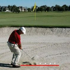 Golf Swing Drills Find a practice bunker and work on this drill to achieve a consistent point of entry about two inches behind the ball on sand shots. Golf Chipping Tips, Golfer, Best Golf Courses, Golf Instruction, Golf Putting, Putting Tips, Golf Channel, Golf Exercises, Golf Tips For Beginners