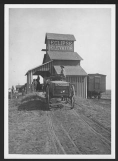 Eclipse Elevator, South Haven, Kansas This black and white photograph shows Charles Robinson seated in a horse-drawn wagon filled with grain at the Eclipse Elevator in South Haven, Kansas. Date: Between 1880s and 1890s