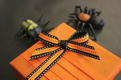 Jane Means has the perfect ribbon for wrapping up presents for Halloween parties. Two ribbons can be mixed together with a vibrant orange tissue and a few novelty spiders thrown in. Jane Means' black stitched ribbon is available on a 3M, 10M and 100M roll and also tied in is a saffron skinny 10m ribbon for her new spice collection. The tissue is supplied by Suttons Packaging. www.janemeans.com