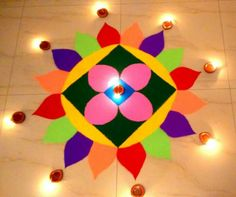 Creative rangoli designs Perfect For Sprucing Diwali Rangoli designs 2019 are about incorporating flowers in them. Flower wedding rangolis have gained much popularity this wedding season. Happy Diwali Rangoli, Easy Rangoli Designs Diwali, Rangoli Simple, Indian Rangoli Designs, Simple Rangoli Designs Images, Rangoli Designs Latest, Rangoli Designs Flower, Free Hand Rangoli Design, Rangoli Border Designs