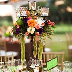 Tall Candelabra Centerpieces. More of the Spanish style you might be looking for, but do the flowers in a softer color if you want; maybe mix in succulents