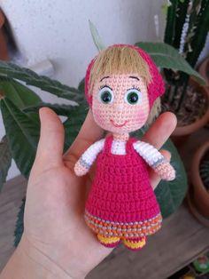 They are Masha, one of the most popular cartoon characters for children. Crochet Amigurumi, Amigurumi Doll, Crochet Toys, Crochet Baby, Disney Crochet Patterns, Most Popular Cartoons, Couleur Fuchsia, Walt Disney Animation Studios, Plush Pattern