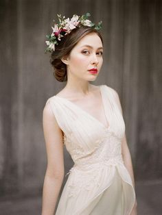 Plunging neckline, applique details and a gorgeous chiffon train – this stunning wedding dress has it all.