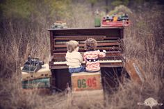 Kids playing piano in a field