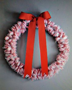 I made this wreath for Christmas with peppermint striped candies, wrapped and glued to a round post. Gave it to a friend who said he hung it on his door at work and all the candies were gone in a day! haha! You just unwrap them and leave the paper there!