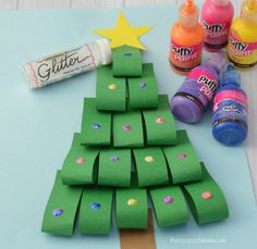This Paper Loops Christmas Tree Craft is a fun way to add dimension and sparkle to your Christmas kid crafts using paper.