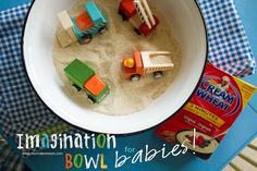 Imagination Bowl for Babies using cream of wheat for (edible) sand! Brilliant idea for a toddler activity!