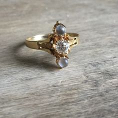 Antique moonstone and Old Mine Cut diamond 14K by VictoriaVVintage on Etsy