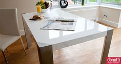 The Angola White Gloss Dining table is a beautiful, contemporary dining table which is perfect for a modern kitchen or dining room. It has a funky minimalistic design with sharp, smooth straight lines that make it stand out from the crowd. Its high gloss white surface reflects light to create the illusion of space in your dining area. The high gloss table surface is enhanced beautifully by the brushed steel frame and legs, which in turn create funky triangular inserts. £229.00