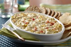 Chicken and artichoke dip made with AE Cottage Cheese and Greek Yogurt add flavor and creamy texture to this pub classic. Delicious as a baked potato topper too.