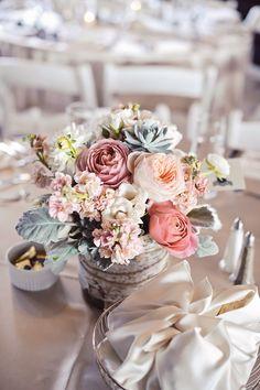 Azalea Floral Design - Centerpiece. Blush pink garden roses, peach Juliet garden roses, peach stock flowers, echeveria dusty green succulents, dusty miller, birch bark wrapped vase. Vintage romantic wedding. Branford House.