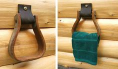 This style could go english... stirrup iron with a short leather strap and decorative screw to attach to wall