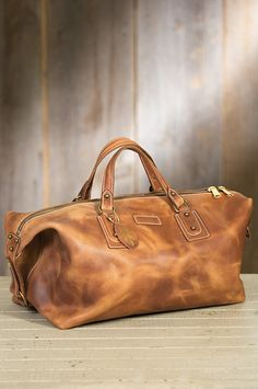 The spacious Americana accommodates your clothing and supplies with a vintage leather design that improves with age.