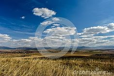 Photo about Field and mountains seen from the city`s hill on a summer day. Image of mountains, panorama, skyline - 111796857 Summer Days, Sunny Days, Opera House, Skyline, Europe, Mountains, City, Amazing, Travel