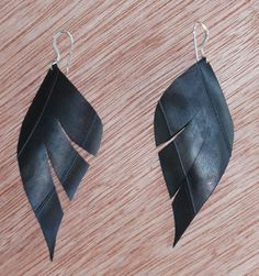 My favorite earrings! Made from the inner tube of a bike! Loce them...Biker Feather Earrings by ecomesa on Etsy