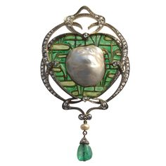 FONSEQUE ET OLIVE An Impressive Art Nouveau Brooch/Pendant,  This pendant is an exceptional example of the fusion of Japonisme and Art Nouveau in France. The background in plique-à-jour enamel represents a lily pond in the Japanese cloisonné manner on which a magnificent blister pearl set in gold appears to float. The fine diamond-studded frame surround shows the elegant and characteristic swirls of the French Art Nouveau style. circa 1895.