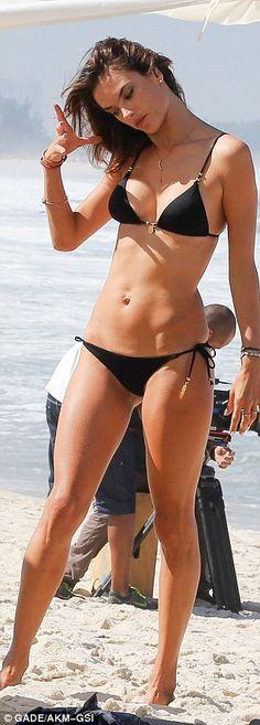 Beach shoot: Alessandra was joined by a camera crew as she prepared for a bikini photo ses...