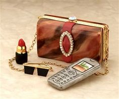 Limoges Brown Purse Box with Telephone, Lipstick, and Sunglasses.