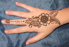 Simple and effective!  Floral Hand Henna Design by Modern Magik Body Art, via Flickr