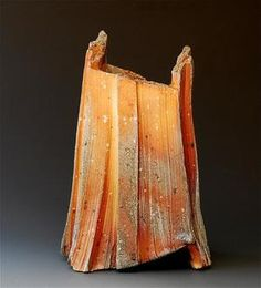 This piece reminds me of architecture and fire. The color is amazing and the form is rigid while seeming still to move. Akira Satake. woodfired 43 ( vase ) 12 x 7.5 x 7.5 inches
