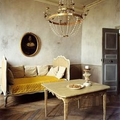 There is a really, really striking blend of rococo grandeur and paired down minimalism in this elegant room