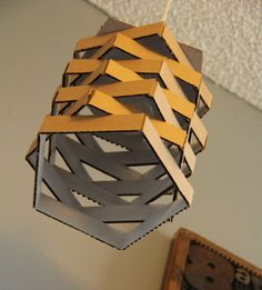 DIY Cardboard Pendant Light  I love stuff made from cardboard,can't you just see this spray painted metalics?