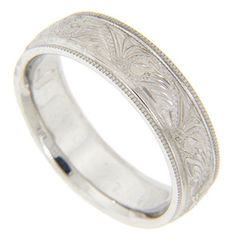 Milgrain edges flank an elaborate engraved design on this 14K white gold antique style men's wedding band. The ring measures 6.1mm in width. Size: 10. Cannot be resized, but we can reorder the ring in any size and in yellow gold, platinum or palladium. Price will vary depending on metal and size. Current cost as shown in white gold is