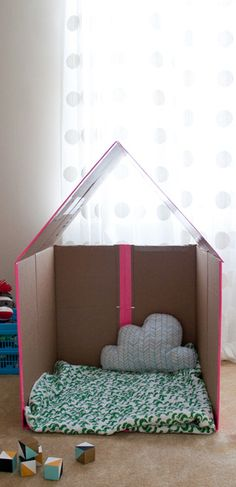 How to make a collapsible cardboard playhouse from an old box!  OK, so kids don't really need help to make a cubby from a box - but there are nifty tips here on how to make it collapsible so you can easily store it away.