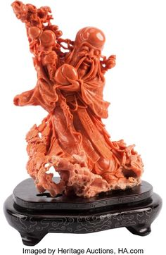 Asian:Chinese, A Chinese Carved Coral Shou-Lao Figure . 9 h x 6 w x 5-1/2 d inches(22.9 x 15.2 x 14.0 cm) (figure, excluding stand). ...