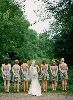 i think my colors will be this gray for the bridesmaids dresses and yellow flowers like this. i love it