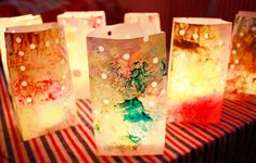 Luminaries: melted crayon art on outside of bags, inside- small votive candle placed in plastic cup.
