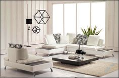 Furniture Beautiful White Ultra Modern Sectional Leather Sofa Including Lovely Black Floral Pattern Small Square Cushion With Cool Chrome Stainless Stell Short Legs Also Modern Low Black Wooden Varnis   Home Decorations