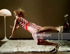 Stock Photo : Young woman tripping over rug