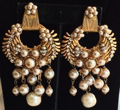 Here is an ultra rare and incredibly beautiful vintage pair of Miriam Haskell earrings. This stunning pair is by far, one of Haskells most