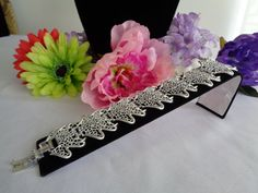 Sarah Coventry Silvertone Bracelet at 7.5 inches. This bracelet is priced at $18.00. You can see the silver filigree style and the signed clasp. A great price for a great bracelet. www.CCCsVintageJewelry.com Have a great vintage day! Best, Coco