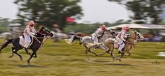 """Great shot! The sport of Tent pegging. """"As they approach the target!"""""""